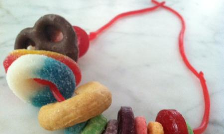 A licorice necklace strung with cereal, pretzels, and candies