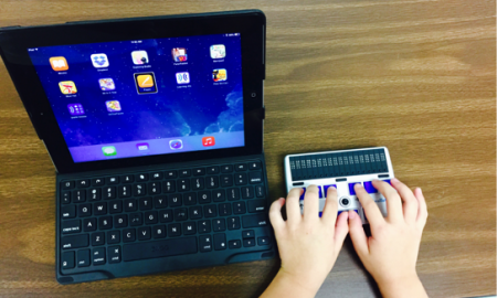 child using refreshable braille display