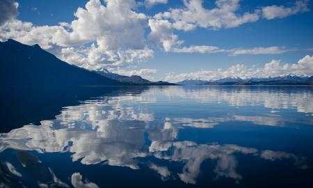 clouds and mountains reflecting in a lake