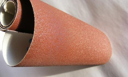 a roll of rough sandpaper