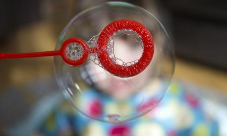 bubble blown by a red plastic wand