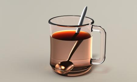 a spoon in a cup of tea