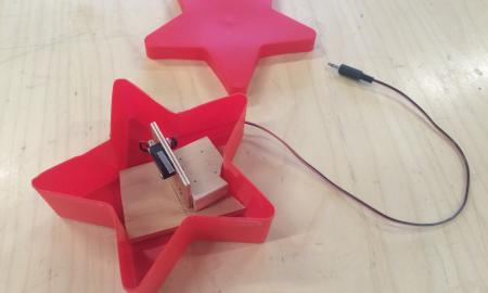 Image of a red plastic star that is modified with a new switch.