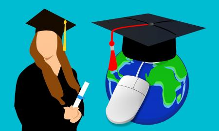 A graduate in cap and gown holding a diploma with an earth globe connecte to a computer mouse