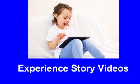 "Laughing young girl sitting on the floor interacting with an iPad and text, ""Video stories"""