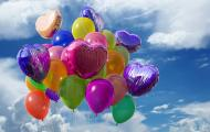 different shapes and colors of mylar balloons inflated with helium