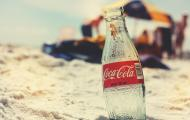 glass coke bottle on a beach