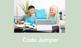 Photo of two young students playing with Code Jumper pods and an android tablet.