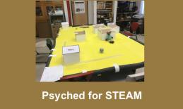 "Photo of Small City CodeSnaps course with text, ""Psyched for STEAM"""