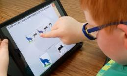7 year-old applying critical thinking strategies while dragging his finger across a row of animals in a Sequencing app.
