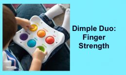 Photo of toddler pressing silicone buttons with index fingers using Dimpl Duo toy.