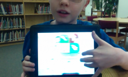 Image of student demonstrating Zoom on an iPad.
