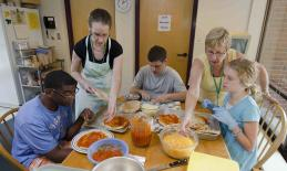 Group making pizza