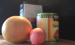A Ball, Grapefruit, Can of Tomatoes and Box of Pasta