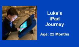 22 month old Luke standing using a 1-finger tap to start an iPad app.