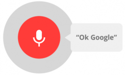 """Microphone on a red circle with the text:  """"Ok, Google"""""""
