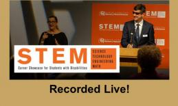 """Image of Ed Summers at a podium beside an interpreter, STEM Career Showcase logo and """"Recorded Live!"""""""
