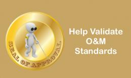 "Image of cartoon O&M character walking with a cane in a circle with ""seal of approval"" and text, ""Help Validate O&M Standards"""