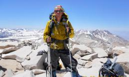 The image is of Trevor Thomas at Mt. Whitney Summit