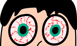 cartoon drawing of a man's head with staring blood-shot eyes.