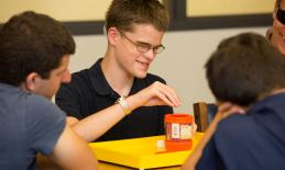 A group of students playing Farkle