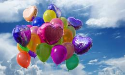 different colored helium balloons