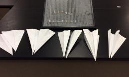APH graph board and various paper airplanes from a student's science project.