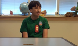 A student discussing his experience at space camp