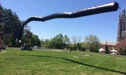 A black plastic tube like bag filled with air rises more than 10 feet into the air!