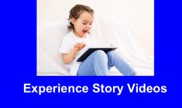 """Laughing young girl sitting on the floor interacting with an iPad and text, """"Video stories"""""""