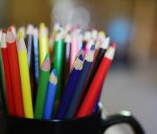 colored pencils in a mug
