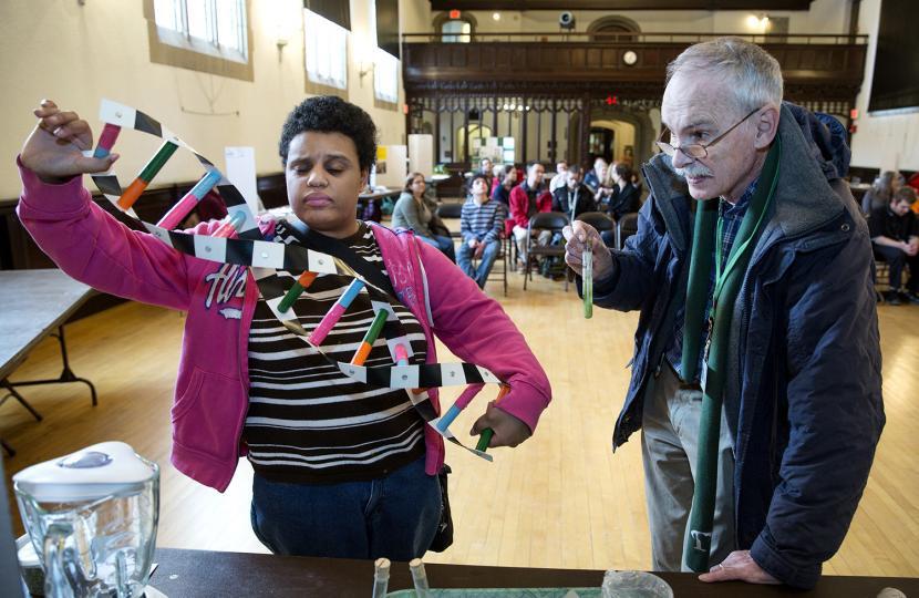 A student displays a model of a DNA helix.