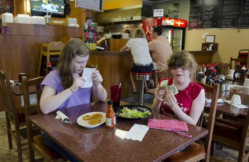 Two people eating breakfast at diner
