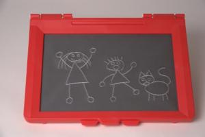 The image is of the inTACT Sketchpad pad with drawn images of children and a dog.