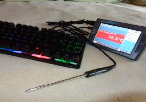 The image is of the new LabQuest 2, a temperature probe, and a keyboard.