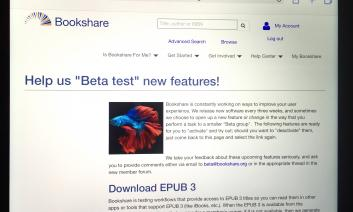 """iPad screen showing picture of fancy beta fish with the Header """"Help us Beta test new features"""" on Bookshare web page"""
