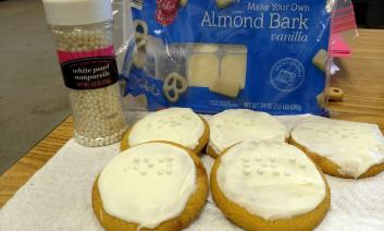 Decorated Braille cookies made with candy pearls for dots,  almond bark, and edible white pearls.