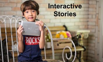 """Young boy with ear buds holding an iPad with text, """"Interactive Stories"""""""