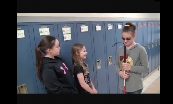 Riley and two of her friends talking beside their lockers.