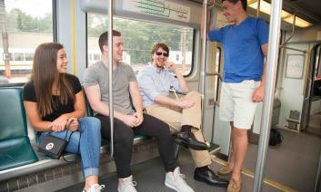 A group of people riding a city bus