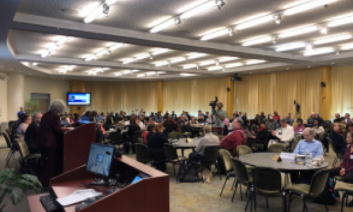 Photo of a large conference room filled with TVIs.