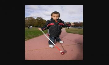 little boy with walking cane