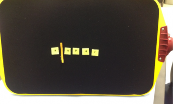 """Tactile representation of a cursor placed between the first and second letter of the braille word """"super"""""""