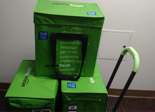 Photo of three AmazonFresh cooler bags on a hand-truck being delivered.