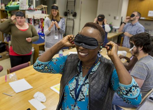 A woman dons an eye mask for a simulation exercise