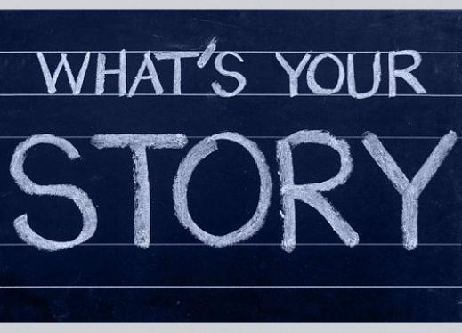"""What's Your Story"" written in chalk on a chalk board."