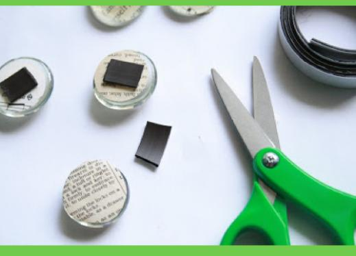 Photo of crafting small refrigerator magnets with scissors and magnetic tape.