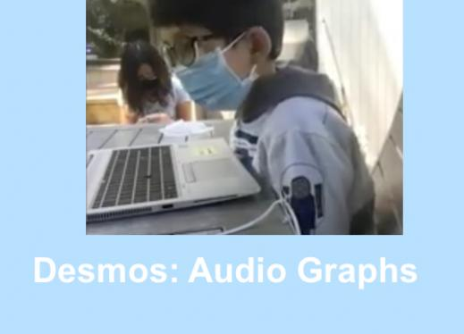 """Second grade boy wearing a mask learning over a computer listening to audio graphs. Text, """"Demos: Audio Graphs"""""""