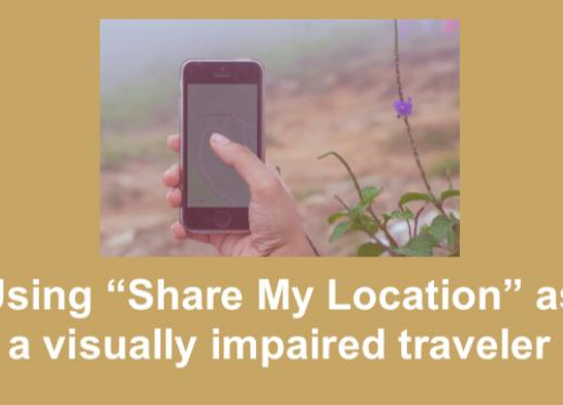 Image of hand holding an iPhone in front of an outdoor trail.