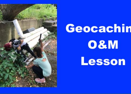 """Two kids reaching behind pipes searching for geocached treasure and text, """"Geocaching O&M Lesson""""."""